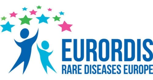 """The EURODIS logo which features two curved figures of people beneath 12 stars, which are featured alternately in the colours blue, green and pink. To the right hand side of the figures is the the words """"EURORDIS. Rare Diseases Europe."""""""